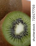 Small photo of Kiwifruit, Actinidia deliciosa, fruit of the Actinidiaceae family native to Asia, on clay trough