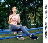 beautiful fitness athlete woman ...   Shutterstock . vector #720203503