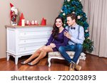 Small photo of Happiness and funny married couple, celebrating christmas tog?ther. Indoor, studio shot