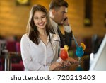 happy young woman drinking...   Shutterstock . vector #720213403
