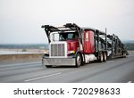 a large red powerful big rig... | Shutterstock . vector #720298633