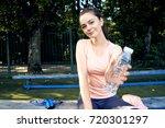 beautiful fitness athlete woman ...   Shutterstock . vector #720301297