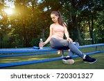 beautiful fitness athlete woman ...   Shutterstock . vector #720301327