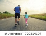 dad and baby jogging in the... | Shutterstock . vector #720314107