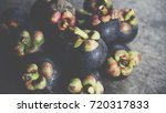 mangosteen on a wood table is a ... | Shutterstock . vector #720317833
