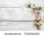 Stock photo spring apple blossom on a old wooden background 720336433