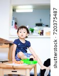 cute child playing indoors   Shutterstock . vector #720375487
