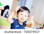 cute child playing indoors   Shutterstock . vector #720375517