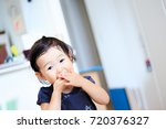 cute child playing indoors   Shutterstock . vector #720376327