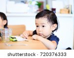 cute child playing indoors   Shutterstock . vector #720376333