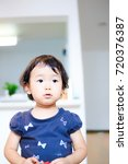 cute child playing indoors   Shutterstock . vector #720376387