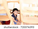cute child playing indoors   Shutterstock . vector #720376393