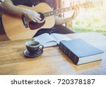 a young man is playing guitar... | Shutterstock . vector #720378187