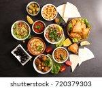 assorted lebanese mezze | Shutterstock . vector #720379303