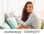 the young joyful woman sitting... | Shutterstock . vector #720393277