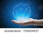 man hand holding global network ...   Shutterstock . vector #720424927