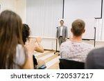 a cheerful mature lecturer on a ... | Shutterstock . vector #720537217