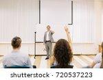 a cheerful mature lecturer on a ... | Shutterstock . vector #720537223