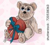 little bear holds his heart in...   Shutterstock .eps vector #720538363