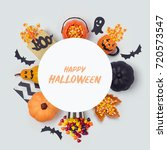 Small photo of Halloween holiday banner design with candy corn and party decorations. View from above. Flat lay