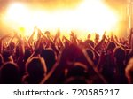 cheering crowd at rock concert... | Shutterstock . vector #720585217