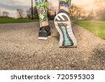 runner woman feet running on...   Shutterstock . vector #720595303