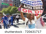 "Small photo of New York City/USA September 22 2017: Near the United Nations Headquarters, at the corner of E 47th Street and 2nd Avenue, a demonstrator holds a sign that says, ""Southern Cameroons Live Free Or Die""."