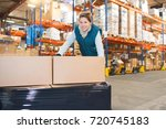female warehouse worker | Shutterstock . vector #720745183
