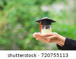woman hand holding coins money... | Shutterstock . vector #720755113