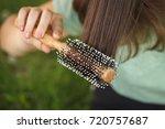 young girl teenager combs her... | Shutterstock . vector #720757687
