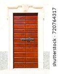 old door    in italy land... | Shutterstock . vector #720764317