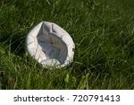 Small photo of deflated soccer ball on green grass/deflated soccer ball/allocated objects