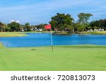 red flag and sand bunker at the ...   Shutterstock . vector #720813073