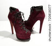 Small photo of Luxury suede claret shoes with a high heel on a white background