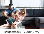 happy young family playing... | Shutterstock . vector #720848797