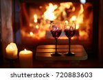 two glasses of red wine near...   Shutterstock . vector #720883603