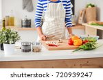 woman making healthy food... | Shutterstock . vector #720939247