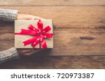 woman holding gifts for special ...   Shutterstock . vector #720973387