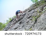 male climber with safety... | Shutterstock . vector #720974173