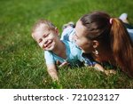young mother with little son... | Shutterstock . vector #721023127
