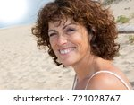 middle aged woman looking at... | Shutterstock . vector #721028767