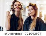 two cute girlfriends in black... | Shutterstock . vector #721043977