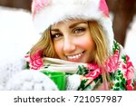 young woman on  outdoor winter... | Shutterstock . vector #721057987