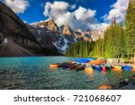 canoes on moraine lake  banff... | Shutterstock . vector #721068607