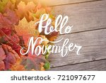 Small photo of Yellow, green and red tree autumn leaves and berries frame composition on old wooden background. Great season texture with fall mood. Nature background with hand lettering Hello November.