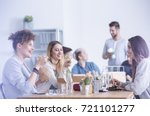 Small photo of Group of young ambitious workers eating their lunch at the office