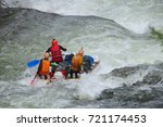 team of people on an inflatable ... | Shutterstock . vector #721174453