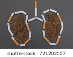 Small photo of Stop smoking. Cigarettes cause cancer and kill. Gray background.
