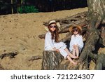 cute girls in hats among the... | Shutterstock . vector #721224307