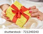 gift box in gentle female hands.... | Shutterstock . vector #721240243